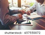 two male employees consulting... | Shutterstock . vector #657550072