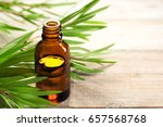 tea tree oil in the amber glass ... | Shutterstock . vector #657568768