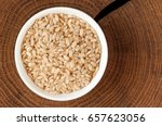 rice in a bowl. bowl with brown ... | Shutterstock . vector #657623056