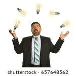 businessman juggling with light ... | Shutterstock . vector #657648562