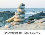 Small photo of A balanced rock stack in front of the ocean.. Rock balancing is a type of problem solving, and some artists consider it as a skill in awareness and meditation. Patience, serenity, reflection, mindful