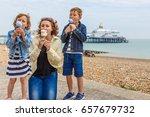Family Eating Ice Cream In...