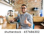 happy man working on laptop ... | Shutterstock . vector #657686302