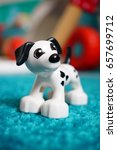 Small photo of POZNAN, POLAND - APRIL 8, 2015: Lego Duplo plastic toy dog standing on a carpet in soft focus