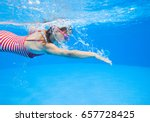 little girl swimming in pool | Shutterstock . vector #657728425
