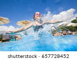 little girl jumping to swimming ... | Shutterstock . vector #657728452