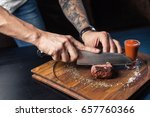 chef cuts the vegetables into a ... | Shutterstock . vector #657760366