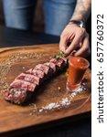 beef steak with grilled... | Shutterstock . vector #657760372