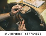 jeweler crafting jewelry | Shutterstock . vector #657764896