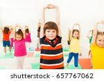 boy stretching hands during... | Shutterstock . vector #657767062