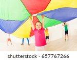girl jumping under tent during... | Shutterstock . vector #657767266