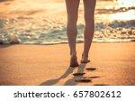 beach holiday. woman walking on ... | Shutterstock . vector #657802612