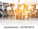 blur image of tire store. | Shutterstock . vector #657851872