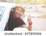 man traveler on the road.... | Shutterstock . vector #657855406