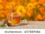 honey bee in glass jar with... | Shutterstock . vector #657889486