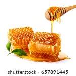 sweet honeycomb and wooden... | Shutterstock . vector #657891445