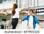 asian girl picking up her... | Shutterstock . vector #657901102