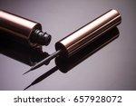 liquid eyeliner brush on black... | Shutterstock . vector #657928072