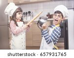 kids dressed as chefs fighting...   Shutterstock . vector #657931765