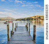 Small photo of Early morning on the old jetty at Akaroa, Canterbury, New Zealand. It was originally settled by the French, and is now famous as the only place in the world where you can swim with Hector's dolphins.
