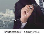 businessman write line graph...   Shutterstock . vector #658048918