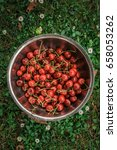 organic cherries in the bowl on ... | Shutterstock . vector #658053262