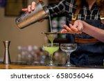 bartender prepares a cocktail | Shutterstock . vector #658056046