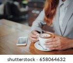 asian business woman drinking...   Shutterstock . vector #658064632