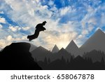 wingsuit extreme sports. man in ... | Shutterstock . vector #658067878