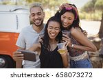 smiling woman with friends... | Shutterstock . vector #658073272