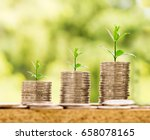 coins stacks on wood table with ... | Shutterstock . vector #658078165