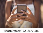 midsection of woman using smart ... | Shutterstock . vector #658079236