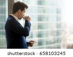 thoughtful businessman drinking ... | Shutterstock . vector #658103245