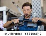 fit man training on row machine ...   Shutterstock . vector #658106842