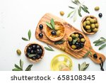 black and green olives in... | Shutterstock . vector #658108345