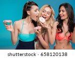 young women in swimwear eating... | Shutterstock . vector #658120138