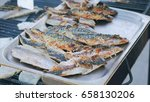 grilled scomber fish on a tray. ...