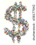 Small photo of Confetti alphabet: sign dollar - figure on isolated background