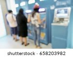 blurred people at atm boxes in... | Shutterstock . vector #658203982