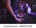 mid section of female musician... | Shutterstock . vector #658207696
