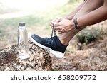 runner tying shoelaces. fitness ... | Shutterstock . vector #658209772