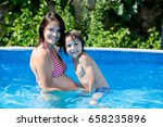 cute child and his pregnant mom ... | Shutterstock . vector #658235896
