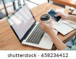 asian hipster male using... | Shutterstock . vector #658236412