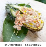 thai sliced pineapple with...   Shutterstock . vector #658248592