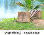 Small photo of old chair deduct riverside in public park