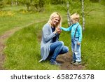 son giving flowers to his... | Shutterstock . vector #658276378