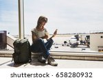 young woman in the airport ... | Shutterstock . vector #658280932