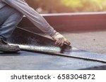 asia worker installing tar foil ... | Shutterstock . vector #658304872