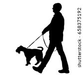 silhouette of man and dog on a... | Shutterstock . vector #658375192