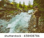 a fisherman caught trout on the ... | Shutterstock . vector #658408786